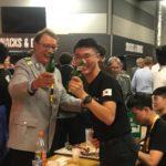 Willi Mausberg mit Koreanern bei der AfterShow-Party